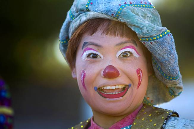 Mariko Iwasa, a clown with the Ringling Bros. and Barnum & Bailey Circus, performs at the Welcome to Fabulous Las Vegas sign Wednesday, June 18, 2014. The circus performs at Thomas & Mack Center Thursday through Sunday.