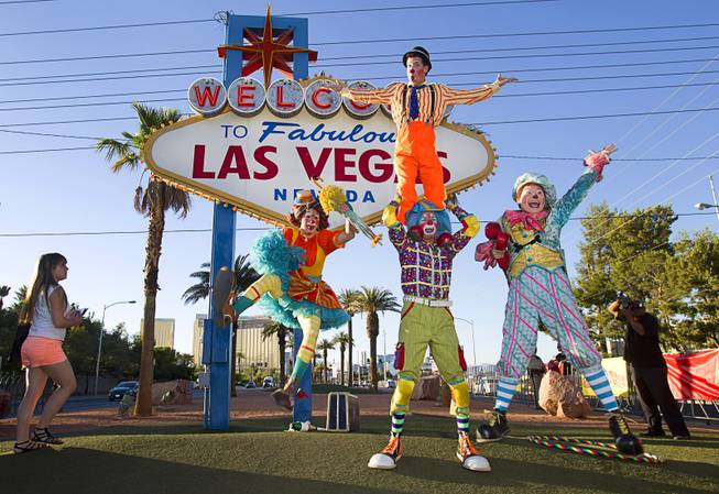 Ringling Bros. and Barnum & Bailey Circus clowns pose in front of the Welcome to Fabulous Las Vegas sign Wednesday, June 18, 2014. The circus performs at Thomas & Mack Center Thursday through Sunday.