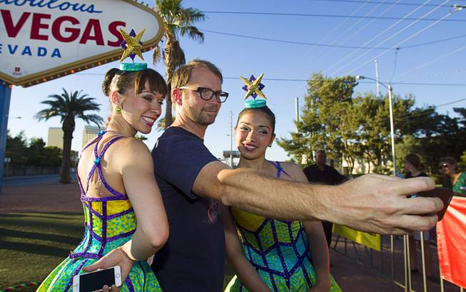 Dave Douglass of Los Angeles takes a selfie with Cossack Riders, Maria Maltseva and Albina Tanasheva of the Ringling Bros. and Barnum & Bailey Circus at the Welcome to Fabulous Las Vegas sign Wednesday, June 18, 2014.