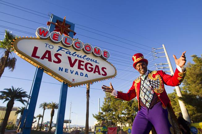 Ringling Bros. and Barnum & Bailey Circus Ringmaster Johnathan Lee Iverson poses at the Welcome to Fabulous Las Vegas sign Wednesday, June 18, 2014. The circus performs at Thomas & Mack Center Thursday through Sunday.