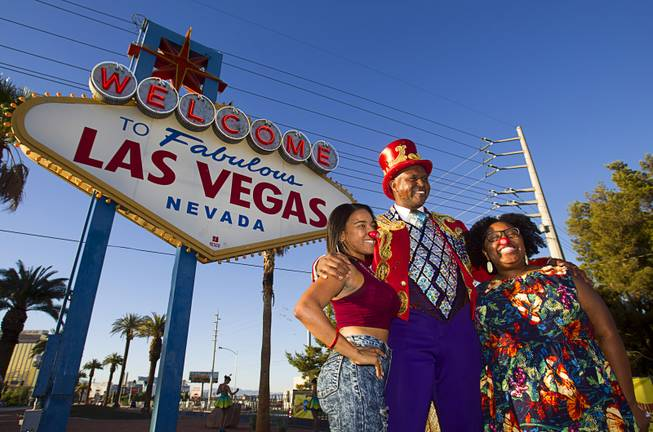 Ringling Bros. and Barnum & Bailey Circus Ringmaster Johnathan Lee Iverson poses with Lena Davis and Danielle Jones at the Welcome to Fabulous Las Vegas sign Wednesday, June 18, 2014. The circus performs at Thomas & Mack Center Thursday through Sunday.