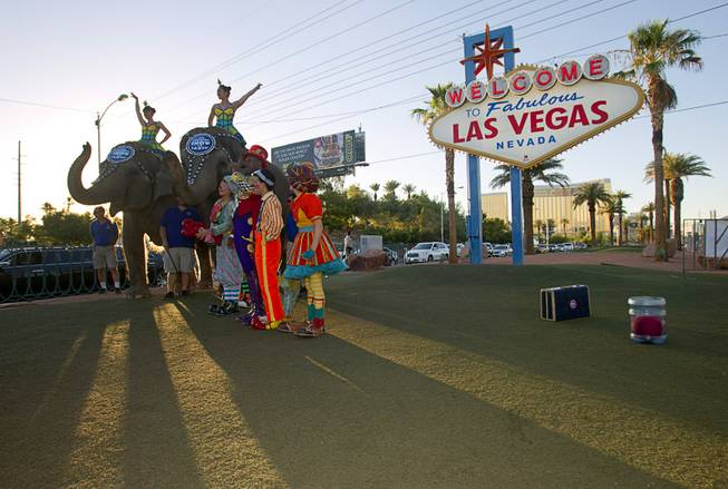 Members of Ringling Bros. and Barnum & Bailey Circus pose for photographs at the Welcome to Fabulous Las Vegas sign Wednesday, June 18, 2014. The circus performs at Thomas & Mack Center Thursday through Sunday.