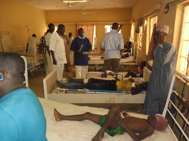 Victims of a suicide bomb explosion at a World Cup viewing center receive treatment at Sani Abacha specialist hospital in Damaturu, Nigeria, Wednesday, June 18, 2014.