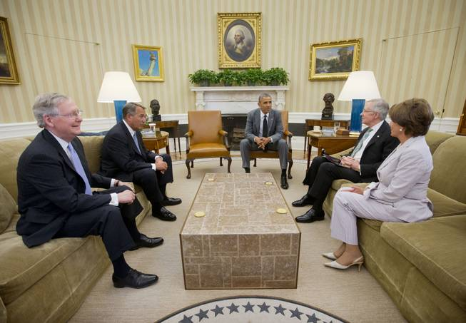 President Barack Obama meets with, from left, Senate Minority Leader Mitch McConnell of Ky., House Speaker John Boehner of Ohio, Senate Majority Leader Harry Reid of Nev., and House Minority Leader Nancy Pelosi of Calif., in the Oval Office of the White House in Washington, Wednesday, June 18, 2014.