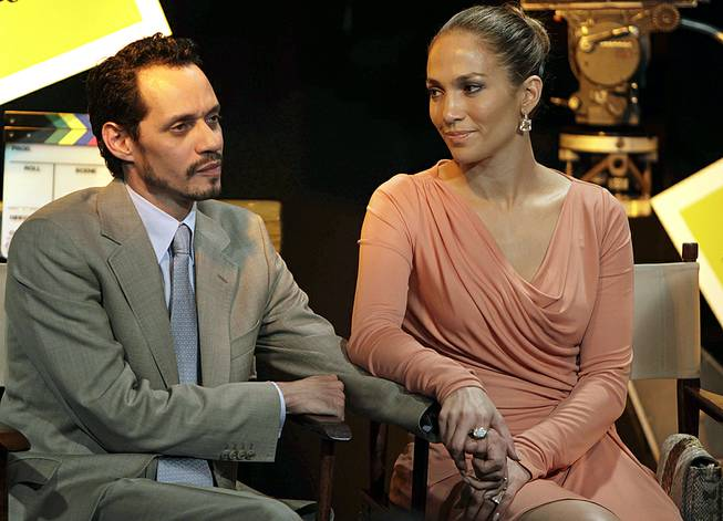 Jennifer Lopez and husband Marc Anthony attend a signing ceremony for filmmaking incentive legislation for the U.S. island territory in Bayamon, Puerto Rico, March 4, 2011.