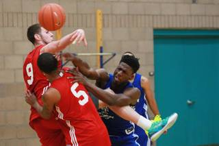 Goodluck Okonoboh has a shot blocked by Ben Carter during their Desert Reign basketball league game Wednesday, June 18, 2014.