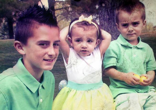 An undated photo provided by family friend Craig Freudlich shows Ella Flores and Cruz Flores, right. The children died in an early morning fire at the home near Ann Road and Durango Drive Thursday, June 19, 2014. The older brother Ryan, left, was not at the home.