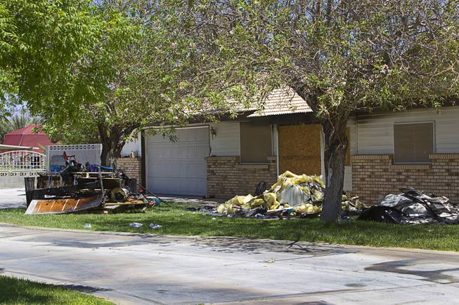 An exterior view of a home is shown after an early morning fatal fire near Ann Road and Durango Drive Thursday, June 19, 2014.  Two children, ages 2 and 4-years-old, died in the fire.