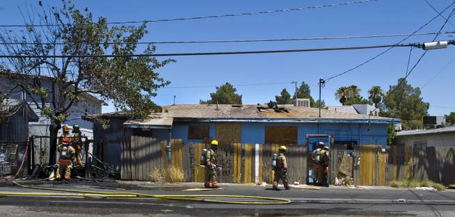 Las Vegas Fire & Rescue circle the property during an apartment fire at 1820 East Lewis Ave. which spread to a nearby tree and shed on Thursday, June, 19, 2014.