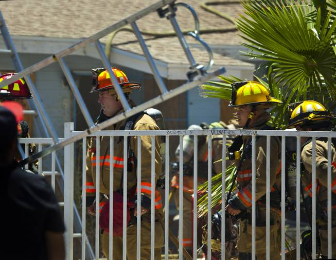 Las Vegas Fire & Rescue work an apartment fire at 1820 East Lewis Ave. which spread to a nearby tree and shed on Thursday, June, 19, 2014.
