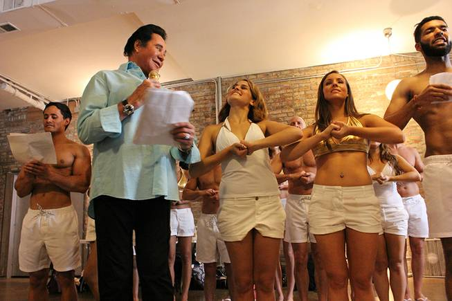 "Wayne Newton rehearses with a group of carolers in Chicago during a trip to promote the ""Vegas Season"" ad campaign by the LVCVA."