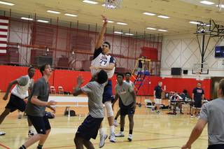 Bishop Gorman High senior center Chase Jeter attempts a shot while others, including Gorman teammate Stephen Zimmerman, look on during Team USA U18 training camp in mid-June 2014 in Colorado Springs, Colo.