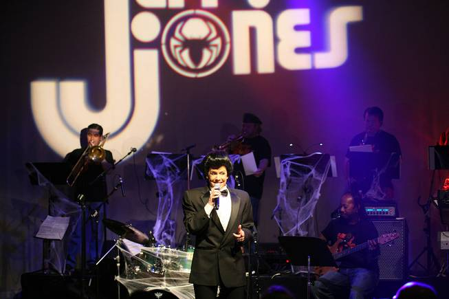 A Wayne Newton impersonator (Kelly Clinton Holmes) performs during a benefit show for Jerry Jones at Lounge at the Palms on Wednesday, June 18, 2014.