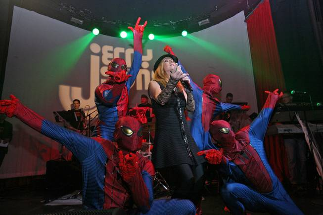 Dancers in Spider-Man outfits perform during a benefit show for Jerry Jones at Lounge at the Palms on Wednesday, June 18, 2014.