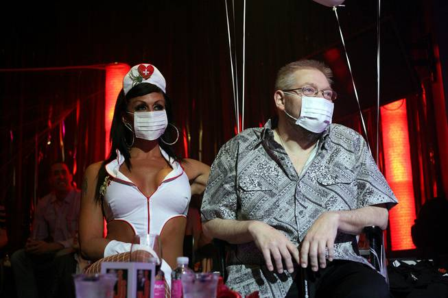 Nurse Jen and Jerry Jones watch performers during a benefit show at Lounge at the Palms on Wednesday, June 18, 2014, to help raise money for his medical bills.