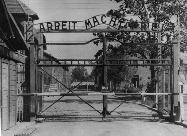 "An undated file image shows the main gate of the Nazi concentration camp Auschwitz I, Poland, which was liberated by the Russians, January 1945. Writing over the gate reads: ""Arbeit macht frei"" (Work makes free - or work liberates). Johann Breyer, 89 faces possible extradition. A German court has charged him with aiding in the killing of 216,000 Jewish men, women and children during World War II."