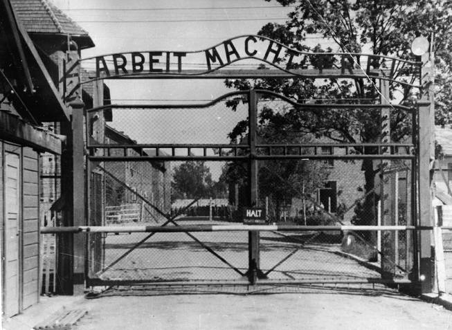 "This undated file image shows the main gate of the Nazi concentration camp Auschwitz I, Poland, which was liberated by the Russians, January 1945. Writing over the gate reads: ""Arbeit macht frei"" (Work makes free — or work liberates). Johann Breyer, 89, who has admitted he was an SS guard at Auschwitz in occupied Poland, faces possible extradition to Germany."