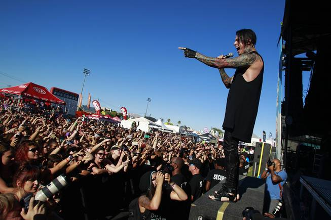 Ronnie Radke and Falling in Reverse perform during the Las Vegas stop of the Vans Warped Tour Thursday, June 19, 2014.