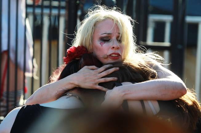 "Emilie Autumn hugs fans during her performance titled ""The Asylum For Wayward Victorian Girls"" during the Las Vegas stop of the Vans Warped Tour Thursday, June 19, 2014."