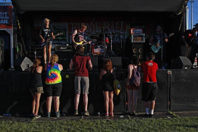 A half dozen fans are seen on hand for the start of Cincinnati band Mixtapes set during the Las Vegas stop of the Vans Warped Tour Thursday, June 19, 2014.