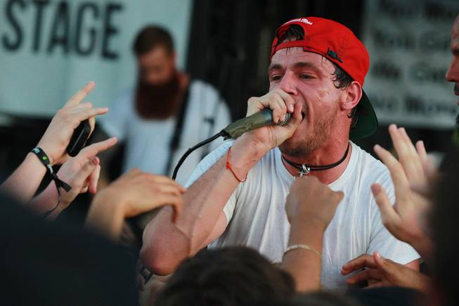 Lead singer Garret Rapp performs with the band The Color Morale during the Las Vegas stop of the Vans Warped Tour Thursday, June 19, 2014.