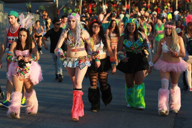 Festival goers make their way in to the Las Vegas Motor Speedway during the first night of the Electric Daisy Carnival Friday, June 20, 2014.