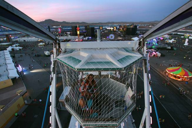 A couple takes a ride in a Ferris wheel during the first night of the Electric Daisy Carnival Friday, June 20, 2014 at the Las Vegas Motor Speedway.