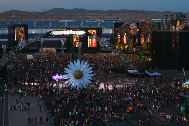 Attendees make their way to the Kinetic Field stage during the first night of the Electric Daisy Carnival Friday, June 20, 2014 at the Las Vegas Motor Speedway.
