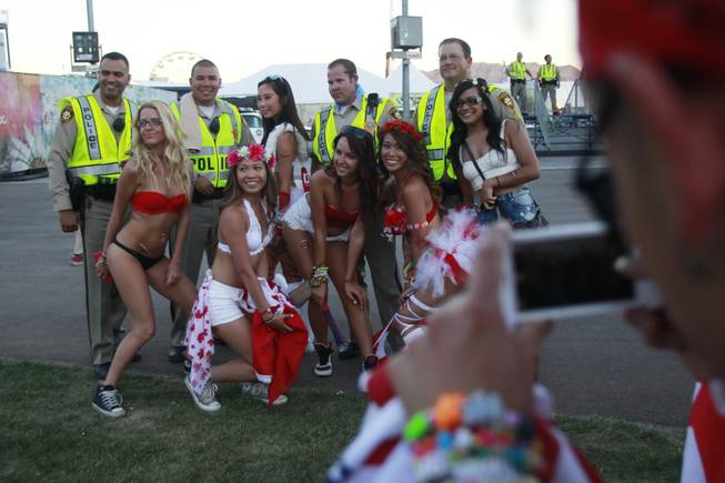 Metro officers pose for a photo with attendees during the first night of the Electric Daisy Carnival Friday, June 20, 2014 at the Las Vegas Motor Speedway.