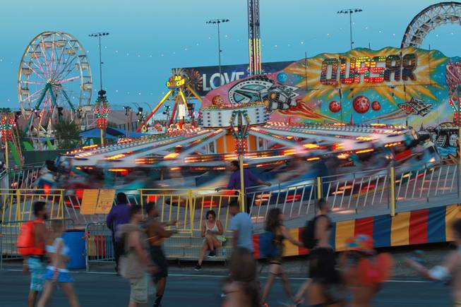 Midway rides operate during the first night of the Electric Daisy Carnival Friday, June 20, 2014 at the Las Vegas Motor Speedway.