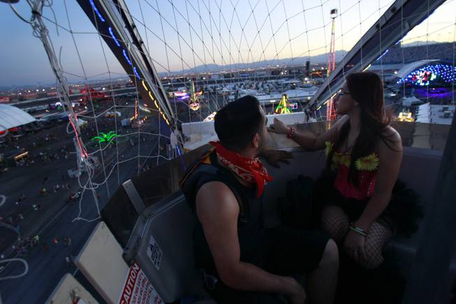 Jose Nunez and Nallely Rodriguez get a view of the festival grounds during the first night of the Electric Daisy Carnival Friday, June 20, 2014 at the Las Vegas Motor Speedway.