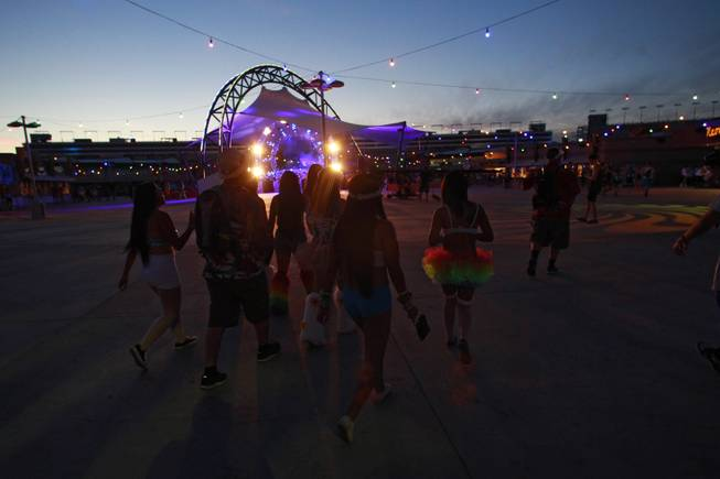 Attendees walk past the Discovery Stage during the first night of the Electric Daisy Carnival Friday, June 20, 2014 at the Las Vegas Motor Speedway.