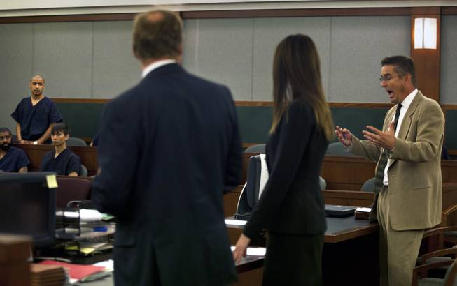 Attorneys argue as Julio Renteria stands before the judge during his preliminary hearing at the Justice Center with Adrian McClintock on Friday, June 20, 2014. The two are suspects in a Boulder Highway carjacking gone awry that ended in Dylan Joshua Salazar's fatal shooting.
