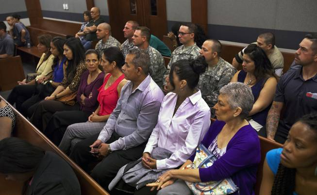 Attendees in support of Dylan Joshua Salazar listen during the preliminary hearing for Julio Renteria and Adrian McClintock at the Justice Center on Friday, June 20, 2014.