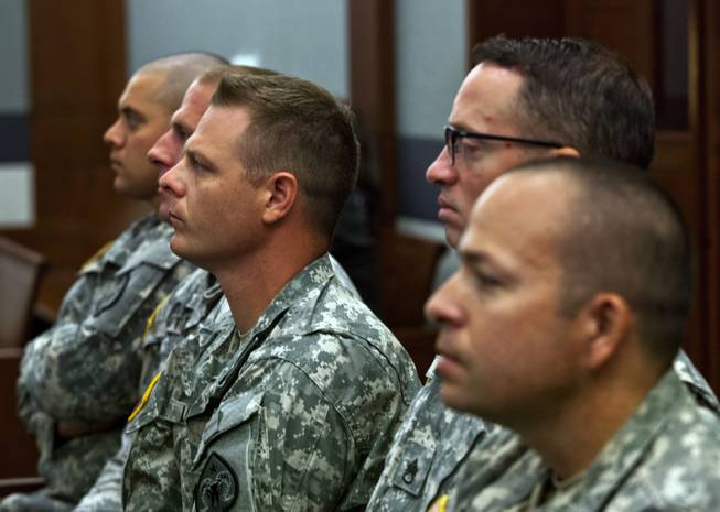 Military attendees in support of Dylan Joshua Salazar listen during the preliminary hearing for Julio Renteria and Adrian McClintock at the Justice Center on Friday, June 20, 2014.  Salazar was with the Nevada National Guard.