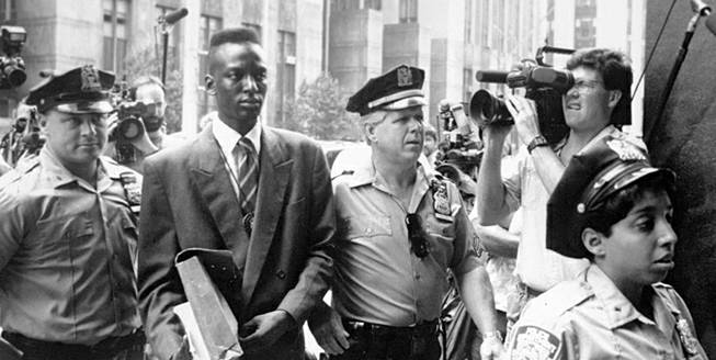 "This 1990 file photo provided by Sundance Selects shows accused rapist Yusef Salaam, second right, being escorted by police in New York in 1990. Salaam is the subject of the documentary, ""The Central Park Five,"" about the 1989 case of five black and Latino teenagers who were convicted of raping a white woman in Central Park. A city official said Friday, June 20, 2014 that New York City has agreed to a $40 million settlement in a civil rights lawsuit filed against police and prosecutors by Salaam and four co-defendants exonerated in the notorious case of a jogger attacked in Central Park in 1989."