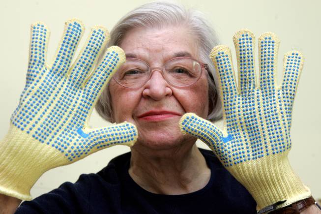 Stephanie Kwolek, 83, shown in this June 20, 2007, file photo taken in Brandywine Hundred, Del., wears regular house gloves made with the Kevlar she invented. Her friend, Rita Vasta, told The Associated Press that Kwolek died Wednesday in a Wilmington hospital at age 90.