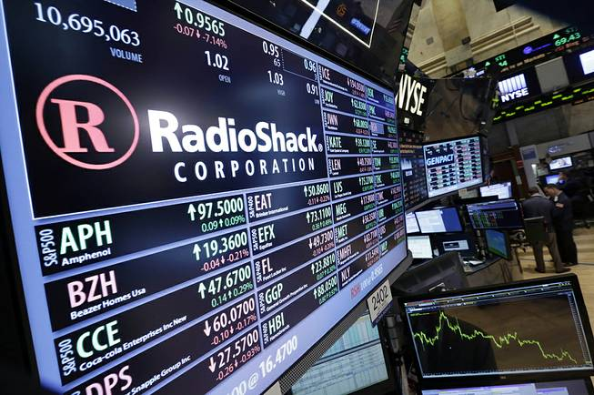 Traders work on the floor of the New York Stock Exchange near the post that handles Radio Shack, Friday, June 20, 2014.