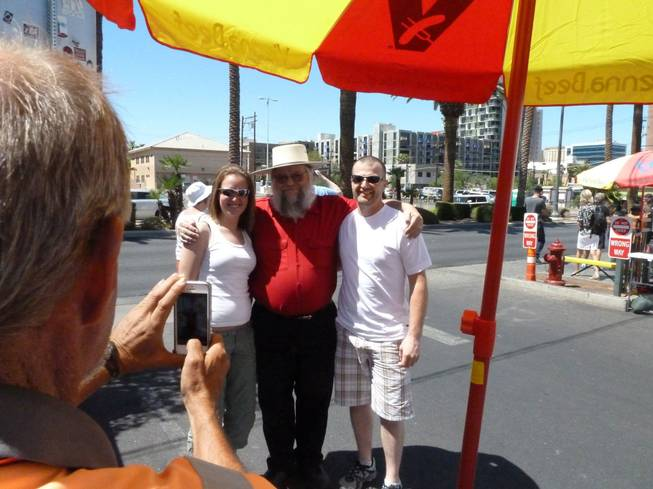 "Mark Hall-Patton, center, poses for photos with fans outside the pawn shop featured on television's ""Pawn Stars"" in Las Vegas. Hall-Patton, the curator of the Clark County Museum, appears regularly on the show authenticating items brought into the shop."