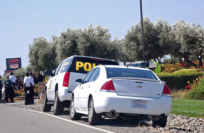 "Vehicles marked ""Tribal Police"" and uniformed personnel post themselves at the parking lot entrances of the Rolling Hills Casino in an attempt to shut down its operations in Corning, Calif., Monday, June 9, 2014. The Northern California Native American casino is at the center of a tense tribal dispute."