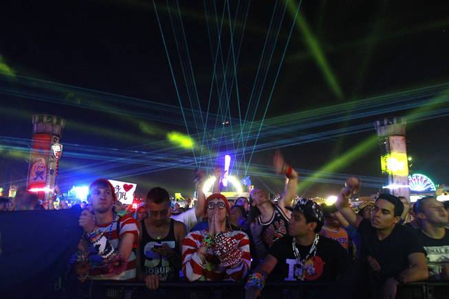 Attendees listen to a set by Lady Faith during the first night of the Electric Daisy Carnival Saturday, June 21, 2014 at the Las Vegas Motor Speedway.