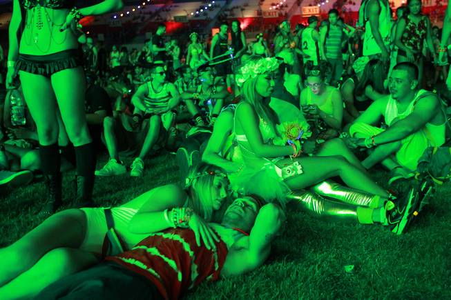 Attendees relax in the Cosmic Meadow during the first night of the Electric Daisy Carnival on Saturday, June 21, 2014, at Las Vegas Motor Speedway.