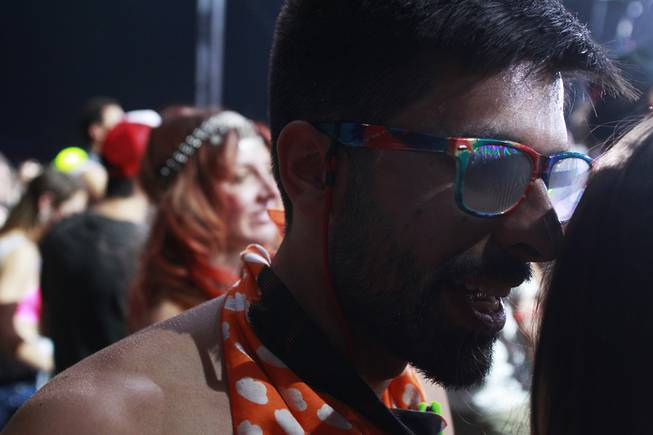 A man talks to a friend during the first night of the Electric Daisy Carnival Saturday, June 21, 2014 at the Las Vegas Motor Speedway.