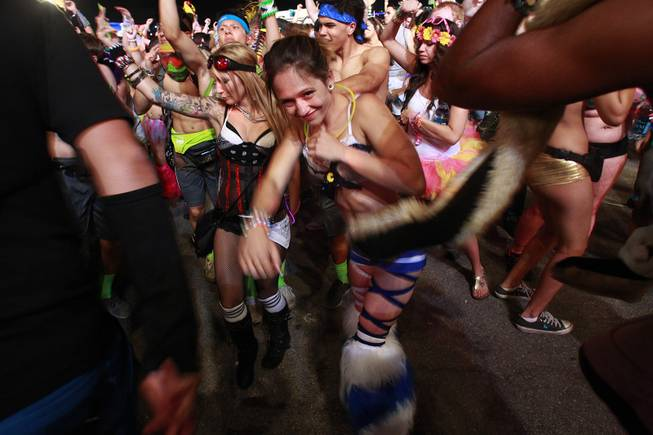 Attendees dance during the first night of the Electric Daisy Carnival Saturday, June 21, 2014 at the Las Vegas Motor Speedway.