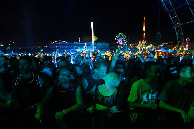 Fans watch a set by Booka Shade during the first night of the Electric Daisy Carnival Saturday, June 21, 2014 at the Las Vegas Motor Speedway.