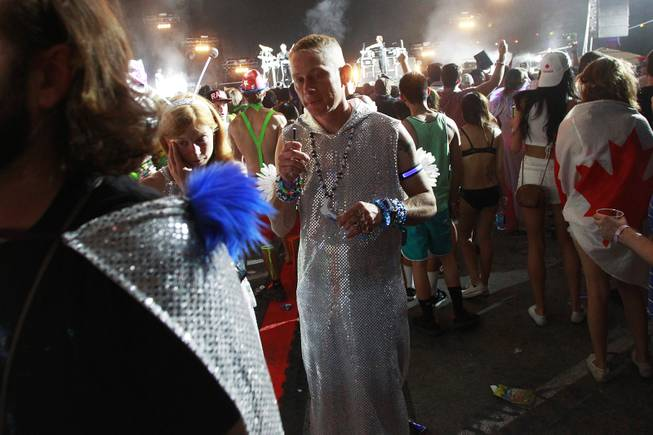 People mill about at the Neon Garden stage during the first night of the Electric Daisy Carnival Saturday, June 21, 2014 at the Las Vegas Motor Speedway.