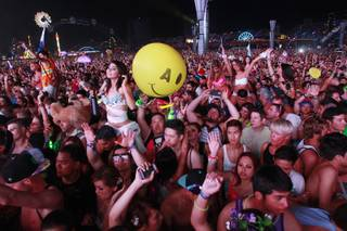 Attendees dance during the first night of the Electric Daisy Carnival early Saturday, June 21, 2014 at the Las Vegas Motor Speedway.