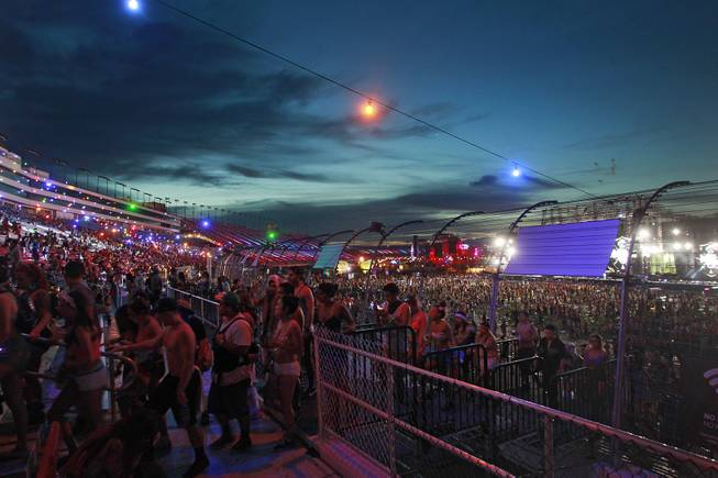 As the sun begins to rise, attendees begin heading for the exits during the first night of the Electric Daisy Carnival early Saturday, June 21, 2014 at the Las Vegas Motor Speedway.