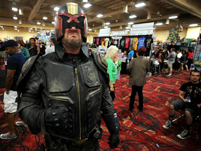 Adam Stines poses as the movie character Judge Dredd during the Las Vegas Comic Con at the South Point Convention Center on Saturday, June 21, 2014.