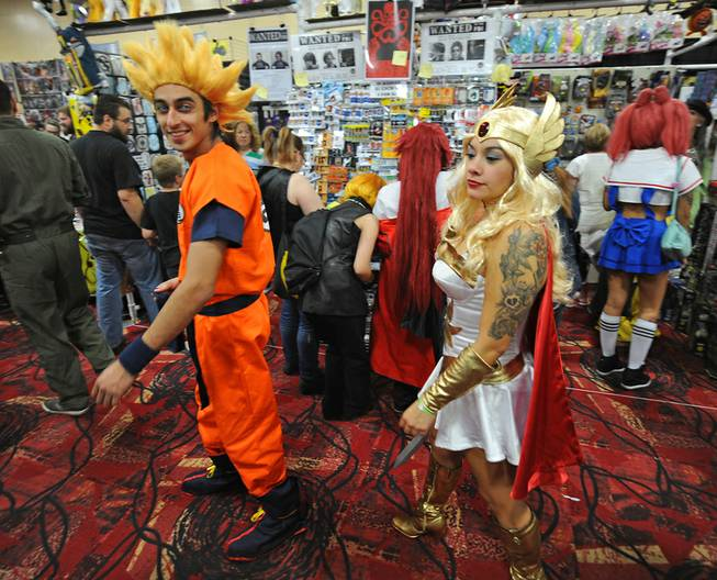 Costumed comic book fans browse booths while attending the first day of the Las Vegas Comic Con at the South Point Convention Center on Saturday, June 21, 2014.